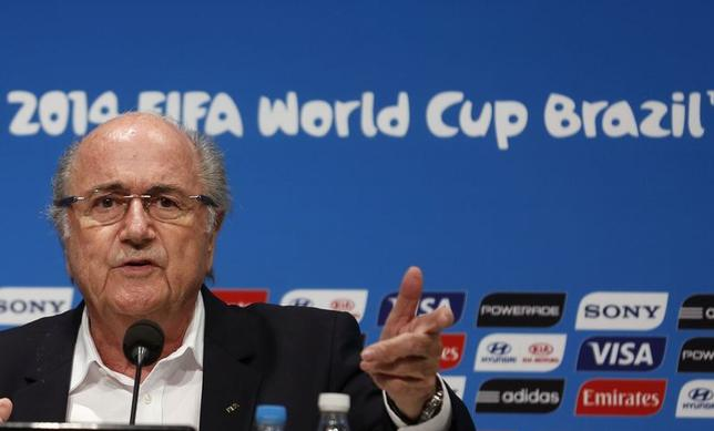 FIFA President Sepp Blatter speaks during a news conference at the Maracana stadium in Rio de Janeiro July 14, 2014. REUTERS/Pilar Olivares/Files