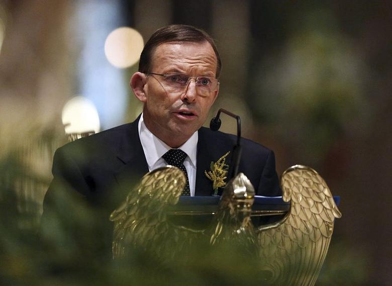 Australian Prime Minister Tony Abbott delivers remarks during a national memorial service for the victims of Malaysia Airlines flight MH17 at St Patrick's Cathedral in Melbourne August 7, 2014. REUTERS/Graham Denholm/Pool