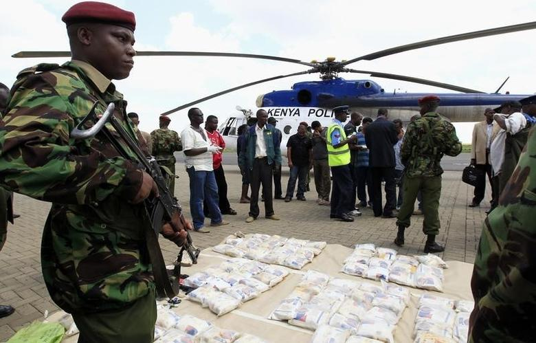 A Kenyan policeman guards seized heroin from the port city of Mombasa at Wilson airport in the capital Nairobi March 25, 2011. REUTERS/Thomas Mukoya
