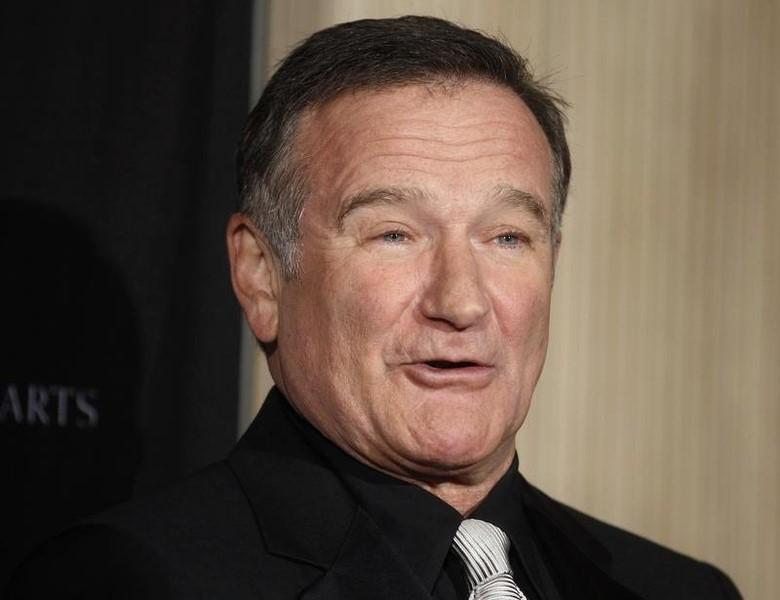 Actor Robin Williams poses as he arrives at the British Academy of Film and Television Arts Los Angeles Britannia Awards in Beverly Hills, California November 30, 2011. REUTERS/Fred Prouser