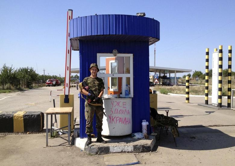 On Russia's border with Ukraine, fighters and...