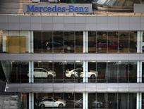 A Mercedez-Benz sign is seen at a dealership in downtown Shanghai August 5, 2014.  REUTERS/Carlos Barria