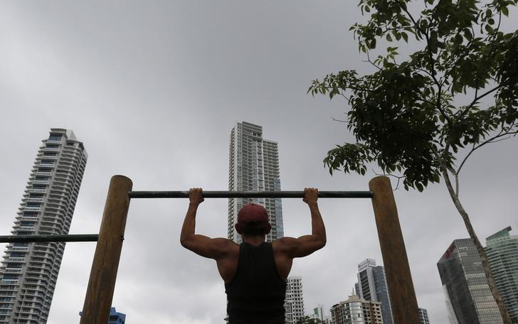A man exercises at a park in Panama City April 29, 2014. REUTERS/Carlos Jasso/Files