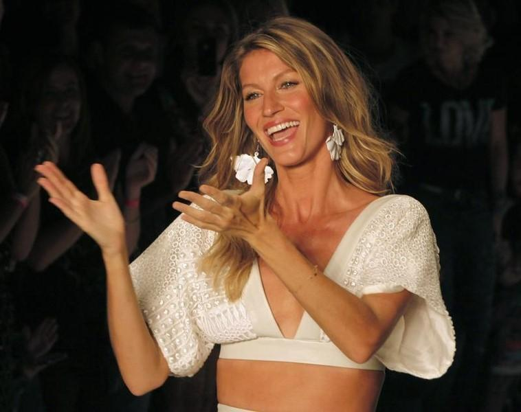 Brazilian top model Gisele Bundchen reacts after presenting a creation from Colcci's Summer 2015 collection at Sao Paulo Fashion Week in Sao Paulo April 2, 2014. REUTERS/Paulo Whitaker