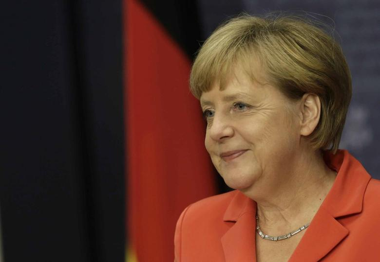 Germany's Chancellor Angela Merkel smiles as she speaks during a news conference in Riga August 18, 2014.  REUTERS/Ints Kalnins