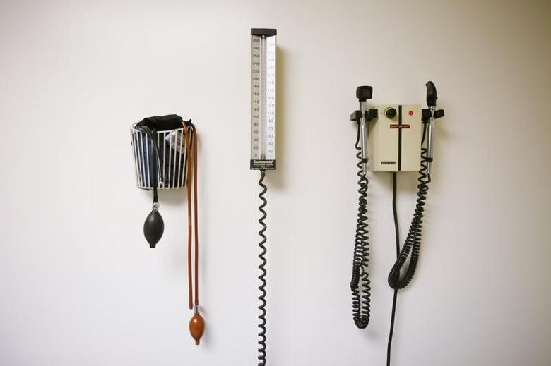 Devices used to take blood pressure, temperature, and examine eyes and ears rest on a wall inside of a doctor's office in New York March 22, 2010.  REUTERS/Lucas Jackson
