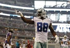 Aug 16, 2014; Arlington, TX, USA; Dallas Cowboys receiver Dez Bryant (88) celebrates after catching a touchdown pass in the first quarter against Baltimore Ravens cornerback Dominque Franks (42) at AT&T Stadium. Matthew Emmons-USA TODAY Sports