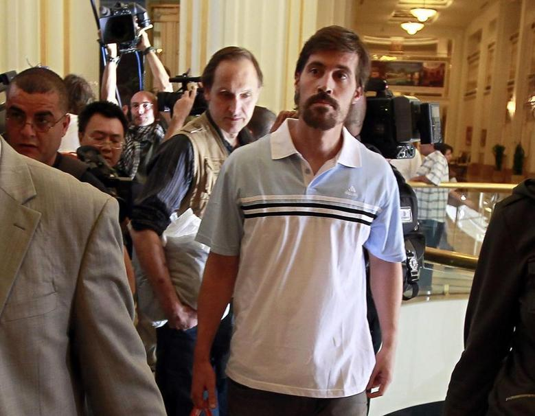U.S. journalist James Foley (R) arrives with fellow reporter Clare Gillis (not pictured), after being released by the Libyan government, at Rixos hotel in Tripoli, in this picture taken May 18, 2011. Picture taken May 18, 2011.  REUTERS/Louafi Larbi