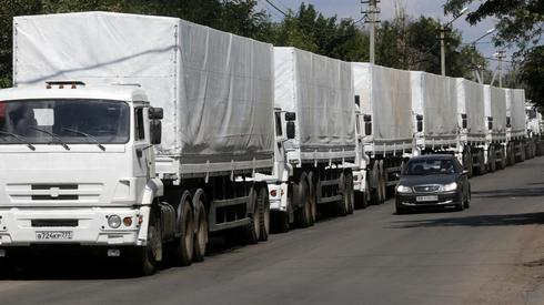 Ukraine border guards begin checks on Russian aid trucks