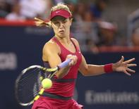 Aug 5, 2014; Montreal, Quebec, Canada; Eugenie Bouchard of Canada plays against Shelby Rogers of Unites States on day two of the Rogers Cup tennis tournament at Uniprix Stadium.  Jean-Yves Ahern-USA TODAY Sports