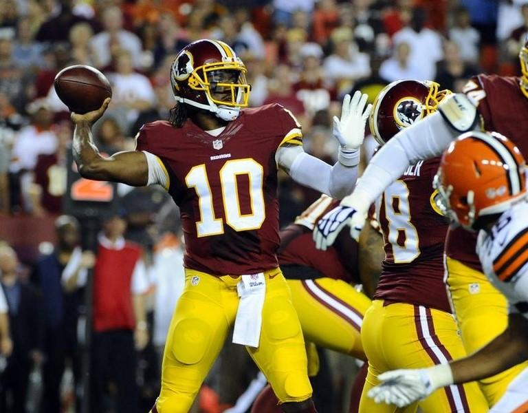 Aug 18, 2014; Landover, MD, USA; Washington Redskins quarterback Robert Griffin (10) drops back to pass against the Cleveland Browns during the first half at FedEx Field. USA TODAY Sports