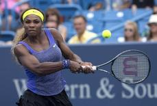 Aug 16, 2014; Cincinnati, OH, USA; Serena Williams (USA) returns a shot against Caroline Wozniacki (not pictured) on day six of the Western and Southern Open tennis tournament at Linder Family Tennis Center.  Aaron Doster-USA TODAY Sports
