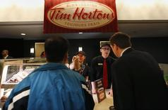 Tim Hortons employees serve shareholders before the company's annual general meeting in Toronto, May 8, 2014. REUTERS/Peter Jones