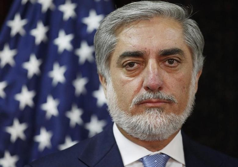 Afghanistan's presidential candidate Abdullah Abdullah listens to U.S. Secretary of State John Kerry during a photo opportunity at the start of a meeting at the U.S. embassy in Kabul July 11, 2014. REUTERS/Jim Bourg