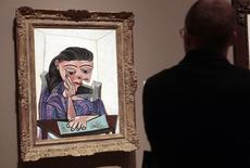 A visitor stops to look at a painting by Picasso at the Detroit Institute of Arts in Detroit, Michigan June 2, 2013. REUTERS/Rebecca Cook
