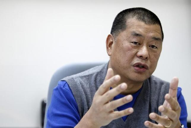 Jimmy Lai, chairman and founder of Next Media, speaks during an exclusive interview with Reuters in Taipei November 29, 2010.  REUTERS/Nicky Loh