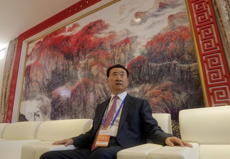 Wang Jianlin, chairman of Chinese property developer Dalian Wanda Group, sits in a meeting room as he arrives for the launch ceremony for the Qingdao Oriental Movie Metropolis on the outskirts of Qingdao, Shandong province September 22, 2013. REUTERS/Jason Lee