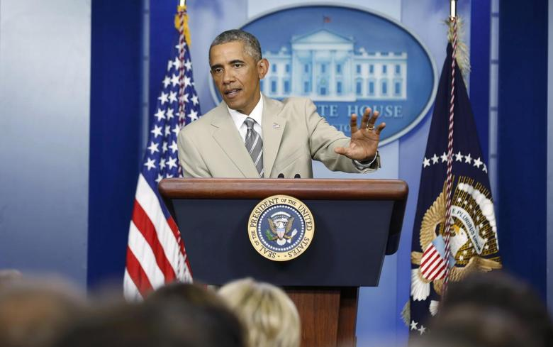 U.S. President Barack Obama addresses reporters in the White House Press Briefing Room ahead of a meeting with his national security council in Washington, August 28, 2014. REUTERS/Larry Downing