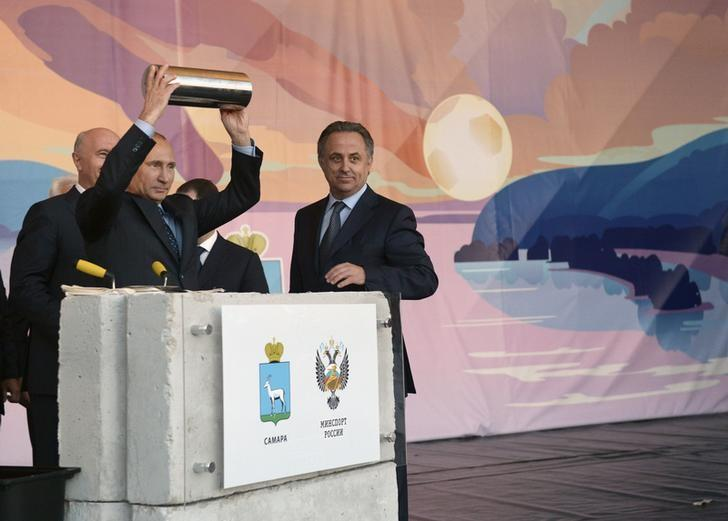 Russia's President Vladimir Putin (L) addresses people as he visits a construction site of the stadium which is expected to host soccer matches of the 2018 World Cup, next to Sports Minister Vitaly Mutko (R), in the city of Samara, July 21, 2014.  REUTERS/RIA Novosti/Alexei Nikolskyi/Kremlin