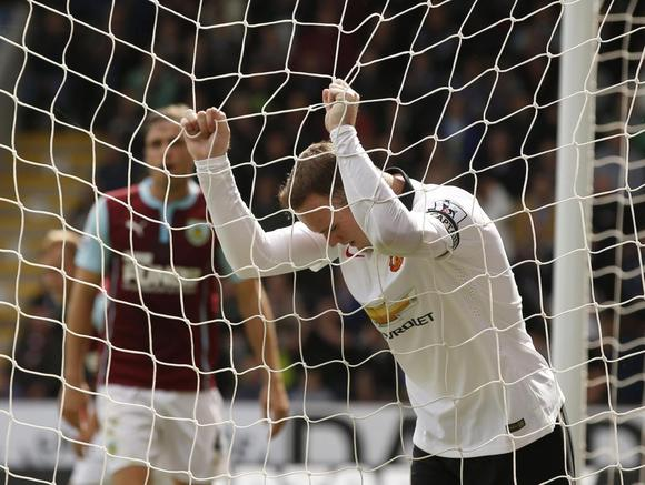 Manchester United's Wayne Rooney reacts after a missed opportunity during their English Premier League soccer match against Burnley at Turf Moor in Burnley, northern England August 30, 2014.    REUTERS/Andrew Yates