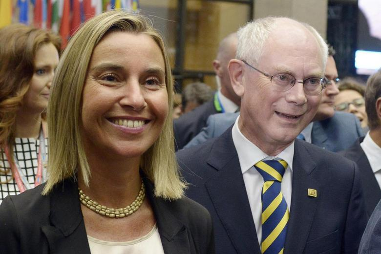 Italian Foreign Minister Federica Mogherini (L) and outgoing European Council President Herman Van Rompuy walk on their way to a news conference during an EU summit in Brussels August 30, 2014.   REUTERS/Eric Vidal
