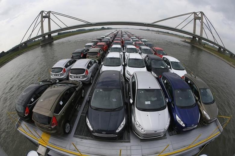 Newly manufactured Ford Fiesta cars are seen on the deck of the car transport ship ''Tossa'' as it travels along the Rhine, from a Ford plant in the German city of Cologne to the Dutch seaport of Vlissingen, close to Nimwegen in the Netherlands September 13, 2013.  REUTERS/Wolfgang Rattay