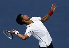 Novak Djokovic of Serbia serves to Philipp Kohlschreiber of Germany during their match at the 2014 U.S. Open tennis tournament in New York, September 1, 2014.       REUTERS/Eduardo Munoz