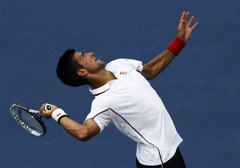 Novak Djokovic of Serbia serves to Philipp Kohlschreiber of Germany during their match at the 2014 U.S. Open tennis tournament in New York, September 1, 2014.       REUTERS/Eduardo Munoz