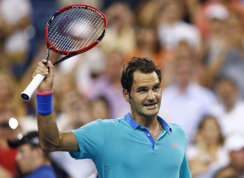 Roger Federer of Switzerland celebrates after defeating Marcel Granollers of Spain in the men's singles play following their match at the 2014 U.S. Open tennis tournament in New York, August 31, 2014. REUTERS/Adam Hunger