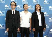 "Director Shinya Tsukamoto (C) poses with cast members Lily Franky (L) and Tatsuya Nakamura during the photo call for the movie ""Nobi"" (Fires on the plain) at the 71st Venice Film Festival September 2, 2014. REUTERS/Tony Gentile"