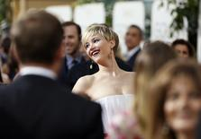 Actress Jennifer Lawrence smiles on the red carpet at the 71st annual Golden Globe Awards in Beverly Hills, California January 12, 2014.  REUTERS/Danny Moloshok