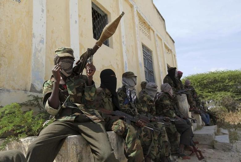 Al Shabaab soldiers sit outside a building during patrol along the streets of Dayniile district in Southern Mogadishu, March 5, 2012. REUTERS/Feisal Omar