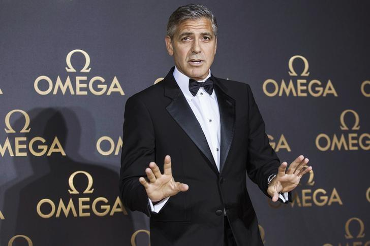 Director and actor George Clooney arrives at Omega's dinner party in Shanghai May 16, 2014. REUTERS/Aly Song