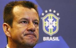 Brazil's new manager Dunga listens to a question during a news conference in Rio de Janeiro July 22, 2014. REUTERS/Ricardo Moraes