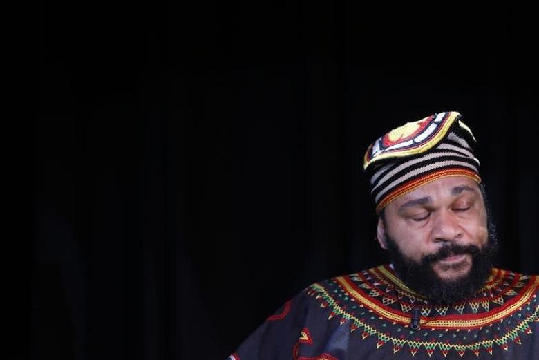 French comedian Dieudonne M'Bala M'Bala, also known as just ''Dieudonne'', attends a news conference at the ''Theatre de la Main d'or'' in Paris January 11, 2014. REUTERS/Gonzalo Fuentes