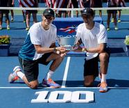 Sep 7, 2014; New York, NY, USA; Bob Bryan (USA) (left) and Mike Bryan (USA) pose with the trophy after beating Marcel Granollers (ESP) and Marc Lopez (ESP) for their 100th doubles win in the men's doubles final of the 2014 U.S. Open tennis tournament at USTA Billie Jean King National Tennis Center. Mandatory Credit: Robert Deutsch-USA TODAY Sports