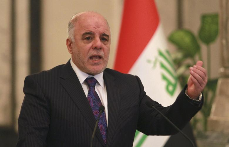 Iraq's Prime Minister-designate Haider al-Abadi gestures during a news conference in Baghdad August 25, 2014.  REUTERS/Mahmoud Raouf Mahmoud