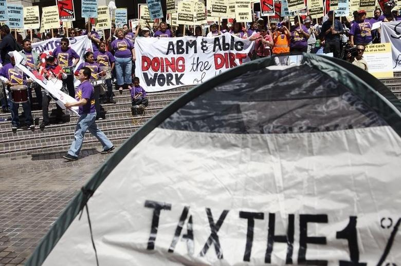 Activists, labor unions and Occupy LA protestors gather at Bank of America Plaza on Tax Day in Los Angeles, California April 17, 2012. REUTERS/Patrick T. Fallon