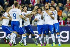 Italianos celebram gol contra a Noruega nesta terça-feira.  REUTERS/Vegard Wivestad Grott/NTB Scanpix