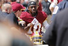 Sep 14, 2014; Landover, MD, USA; Washington Redskins quarterback Robert Griffin III (10) is carted of the field after being injured against the Jacksonville Jaguars in the first quarter at FedEx Field. Mandatory Credit: Geoff Burke-USA TODAY Sports