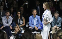 Actor Richard E. Grant (C) watches the presentation of the Anya Hindmarch Spring/Summer 2015 collection during London Fashion Week September 16, 2014. REUTERS/Suzanne Plunkett