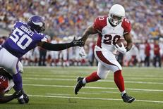 Arizona Cardinals running back Jonathan Dwyer (20) runs with the ball around Minnesota Vikings linebacker Gerald Hodges (50) to score a touchdown in the first quarter at TCF Bank Stadium. Mandatory Credit: Bruce Kluckhohn-USA TODAY Sports