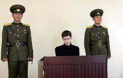 U.S. citizen Matthew Todd Miller sits in a witness box during his trial at the North Korean Supreme Court in this undated photo released by North Korea's Korean Central News Agency in Pyongyang September 14, 2014.  REUTERS