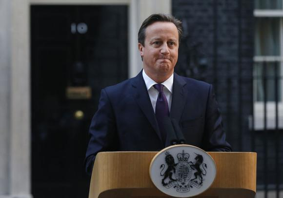 Cameron tries to quell party revolt over new powers for Scotland
