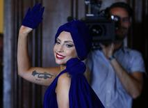 U.S. singer Lady Gaga leaves after a news conference, ahead of her concert with Tony Bennett, in Brussels September 22, 2014.    REUTERS/Yves Herman