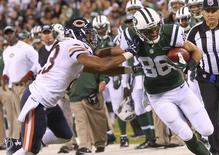Sep 22, 2014; East Rutherford, NJ, USA; New York Jets wide receiver David Nelson (86) holds off Chicago Bears cornerback Kyle Fuller (23) during the third quarter at MetLife Stadium. Chicago Bears won 27-19.  Anthony Gruppuso-USA TODAY Sports