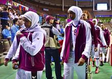 Qatar's women's basketball team leaves the court after forfeiting their women's basketball game against Mongolia at Hwaseong Sports Complex during the 17th Asian Games in Incheon September 24, 2014. REUTERS/Kim Kyung-Min/Sports Chosun
