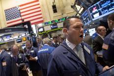 Traders work on the floor of the New York Stock Exchange September 30, 2014. REUTERS/Brendan McDermid