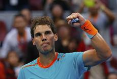Rafael Nadal of Spain celebrates after winning a point  during his men's singles match against Peter Gojowczyk of Germany at the China Open tennis tournament in Beijing October 2, 2014. REUTERS/Petar Kujundzic