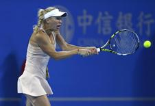 Caroline Wozniacki of Denmark returns the ball during her women's singles tennis match against Samantha Stosur of Australia at the China Open tennis tournament in Beijing, October 1, 2014. REUTERS/Jason Lee